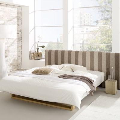 Polsterbett mit Kopfteil und integriertem Schlafsystem